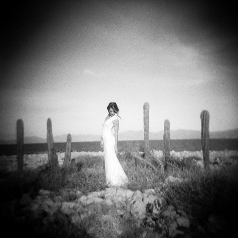 bride on the beach black and white film photography